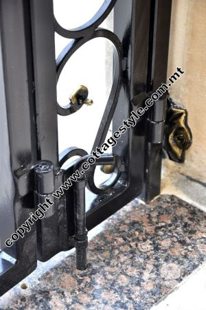 11 www.cottagestyle.com.mt wrought iron gates (new update1.2012).jpg