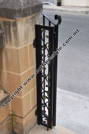 14 www.cottagestyle.com.mt wrought iron gates (new update1.2012).jpg