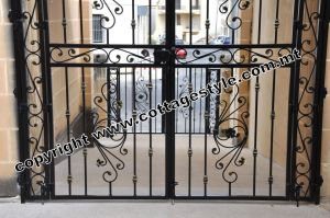 22 www.cottagestyle.com.mt wrought iron gates (new update1.2012).jpg