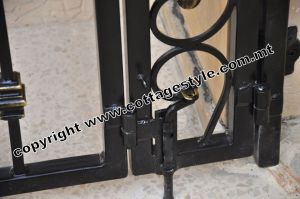 24 www.cottagestyle.com.mt wrought iron gates (new update1.2012).jpg